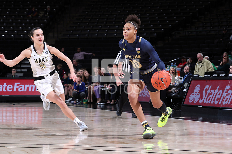 WINSTON-SALEM, NC - FEBRUARY 06: Katlyn Gilbert #10 of the University of Notre Dame drives past Gina Conti #5 of Wake Forest University during a game between Notre Dame and Wake Forest at Lawrence Joel Veterans Memorial Coliseum on February 06, 2020 in Winston-Salem, North Carolina.