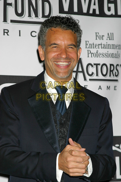 BRIAN STOKES MITCHELL.The Actors Fund of America Gala at the Waldorf Astoria,  New York City, New York, USA, October 30th 2004. .half length hands clasped tanned orange.Ref: IW.www.capitalpictures.com.sales@capitalpictures.com.©Capital Pictures.