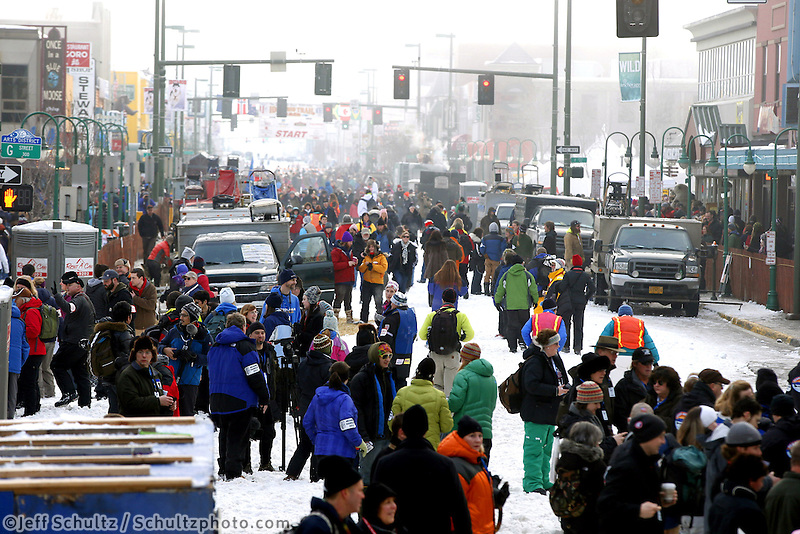 4th Avenue is jammed with people and dog trucks prior to the ceremonial start of the Iditarod sled dog race in downtown Anchorage Saturday, March 2, 2013. ..Photo (C) Jeff Schultz/IditarodPhotos.com  Do not reproduce without permission.