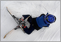A young child/toddler has his first lesson in snow skiing. Photo taken in Pennsylvania, but can be used to illustrate children learning how to ski anywhere. Model released image.