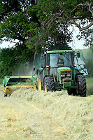Farmer baling summer hay