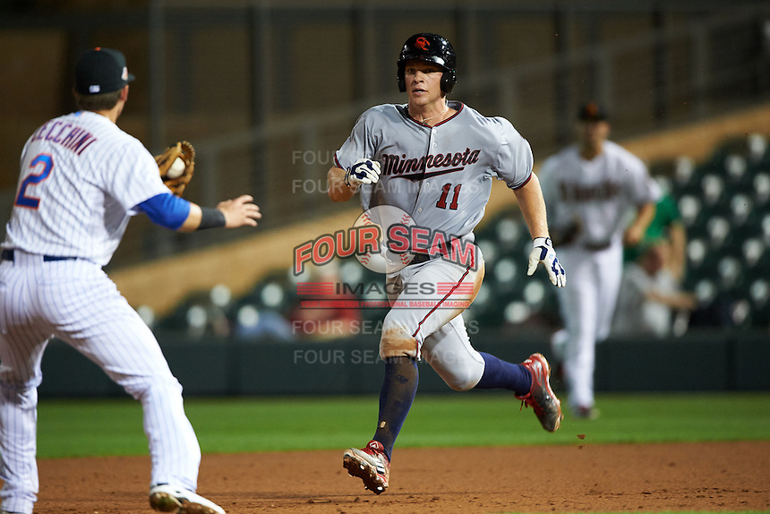 Scottsdale Scorpions catcher Stuart Turner (11) looks to shortstop Gavin Cecchini (2) while running the bases during an Arizona Fall League game against the Salt River Rafters on October 13, 2015 at Salt River Fields at Talking Stick in Scottsdale, Arizona.  Salt River defeated Scottsdale 5-3.  (Mike Janes/Four Seam Images)