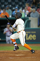 Rodolfo Castro (7) of the Greensboro Grasshoppers follows through on his swing against the Hagerstown Suns at First National Bank Field on April 6, 2019 in Greensboro, North Carolina. The Suns defeated the Grasshoppers 6-5. (Brian Westerholt/Four Seam Images)