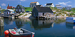 Halifax County, Nova Scota<br /> Morining sun on red skiff and the hillside village buildings of Peggy's Cove