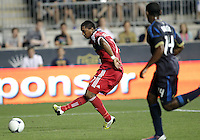 CHESTER, PA - AUGUST 12, 2012:  Amobi Okugo (14) of the Philadelphia Union watches a shot by   Alex (71) of the Chicago Fire during an MLS match at PPL Park, in Chester, PA on August 12. Fire won 3-1.