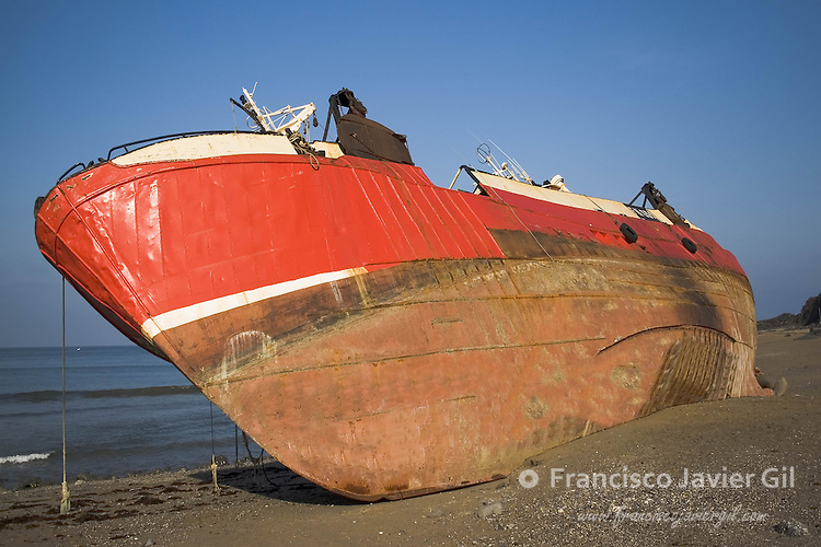 Boat stranded on the beach of Mutriku, Gipuzkoa, Spain