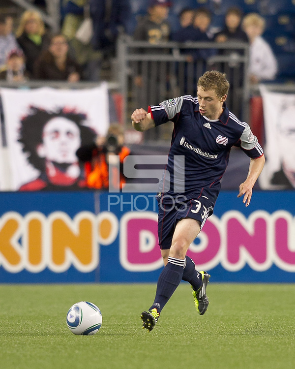 New England Revolution midfielder Zak Boggs (33) dribbles. In a Major League Soccer (MLS) match, the New England Revolution defeated the Vancouver Whitecaps FC, 1-0, at Gillette Stadium on May14, 2011.