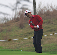 Liang Wen-chong (CHN) chips onto the 5th green during Saturay's Round 3 of the 2014 BMW Masters held at Lake Malaren, Shanghai, China. 1st November 2014.<br /> Picture: Eoin Clarke www.golffile.ie