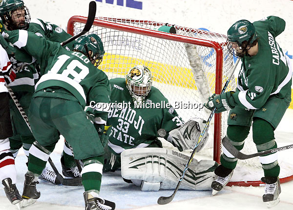 Bemidji State goalie Dan Bakala tracks the puck to make a glove save during the second period. Bemidji State beat UNO 4-2 Friday night during the first round of the WCHA playoffs at Qwest Center Omaha. (Photo by Michelle Bishop)