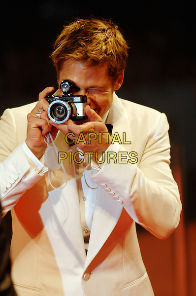 "BRAD PITT.""The Assassination of Jesse James by the Coward Robert Ford"" premiere.64th Venice Film Festival.2nd September 2007, Italy.La Biennale di Venezia, white dinner jacket holding camera taking photograph tuxedo.Ref: CAP/PL.©Phil Loftus/Capital Pictures"