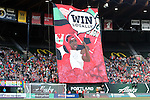"19 June 2015: Portland's supporters group, the Rose City Riveters, raise a large banner reading ""Win Locally"" before the game. The Portland Thorns FC hosted FC Kansas City at Providence Park in Portland, Oregon in a National Women's Soccer League 2015 regular season match. The game ended in a 1-1 tie."