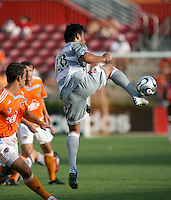 FC Dallas forward Carlos Ruiz (20) plays the ball during an MLS regular season match against the Houston Dynamo at Robertson Stadium in Houston, TX on August 19, 2007.
