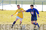 Ballymac North End's Colin McSwiney and Classic's Eddie Lacey.