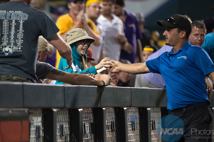OMAHA, NE - JUNE 27: A groundskeeper hands a ball to a fan as Louisiana State University takes on the University of Florida during game two of the Division I Men's Baseball Championship held at TD Ameritrade Park on June 27, 2017 in Omaha, Nebraska. The University of Florida defeated Louisiana State University 6-1 in game two of the best of three series. (Photo by Corey Solotorovski/NCAA Photos via Getty Images)