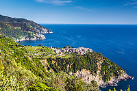 Cornigilia and Manarola clinging to the cliffs of Cinque Terre above the Tyrrhenian Sea on the Italian Riviera of northern Italy.