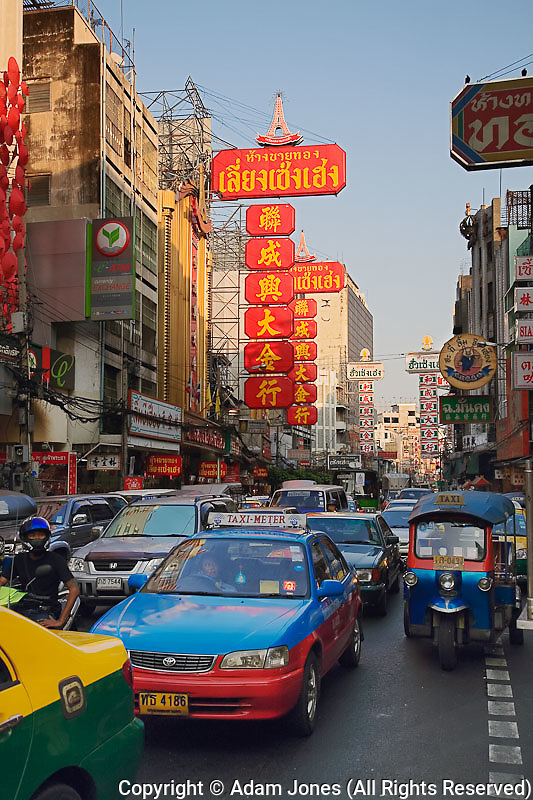 Taxis in crowded streets of Chinatown, Bangkok, Thailand