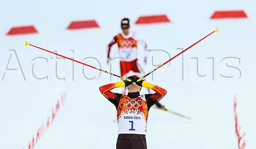 12.02.2014. Sochi, Russia. Winter Olympic Games. Mens Normal Hill combination cross country.  Eric Frenzel (ger) finshes first and takes the gold medal from Akito Watabe (silver) and Magnus Krog (bronze) in the dual combination sport