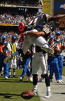 Sept. 17, 2006; San Diego, CA, USA; San Diego Chargers running back (21) LaDainian Tomlinson celebrates with wide receiver (88) Eric Partker after scoring a touchdown against the Tennessee Titans at Qualcomm Stadium in San Diego, CA. Mandatory Credit: Mark J. Rebilas