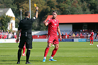 James Ball of Ebbsfleet United is shown a yellow card by Match referee Gary Parsons during Ebbsfleet United vs Notts County, Vanarama National League Football at The Kuflink Stadium on 24th August 2019
