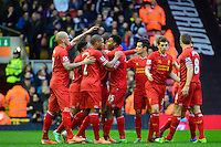 Sunday, 23 February 2014<br /> Pictured: Liverpool players celebrate the opening goal<br /> Re: Barclay's Premier League, Liverpool FC v Swansea City FC v at Anfield Stadium, Liverpool Merseyside, UK.