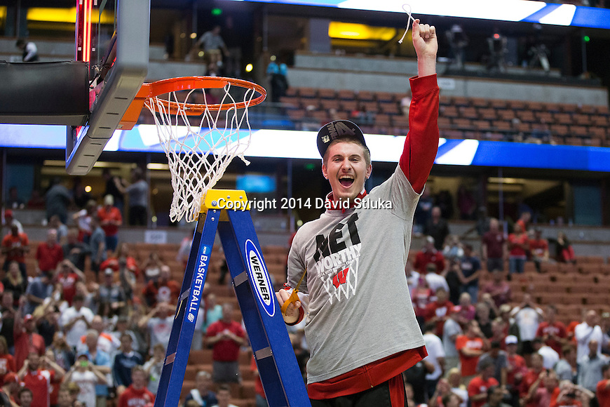 Wisconsin Badgers Aaron Moesch cuts down a piece of the net after the Western Regional Final NCAA college basketball tournament game against the Arizona Wildcats Saturday, March 29, 2014 in Anaheim, California. The Badgers won 64-63 (OT). (Photo by David Stluka)