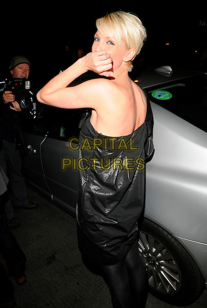 SARAH HARDING (Girls Aloud) .At the Samsung & Cystic Fibrosis Trust Gala Dinner, Bluebird Restaurant, London, England, February 28th 2008..half 3/4 length black dress one shoulder hand over mouth funny looking back over shoulder.CAP/CAN.?Can Nguyen/Capital Pictures