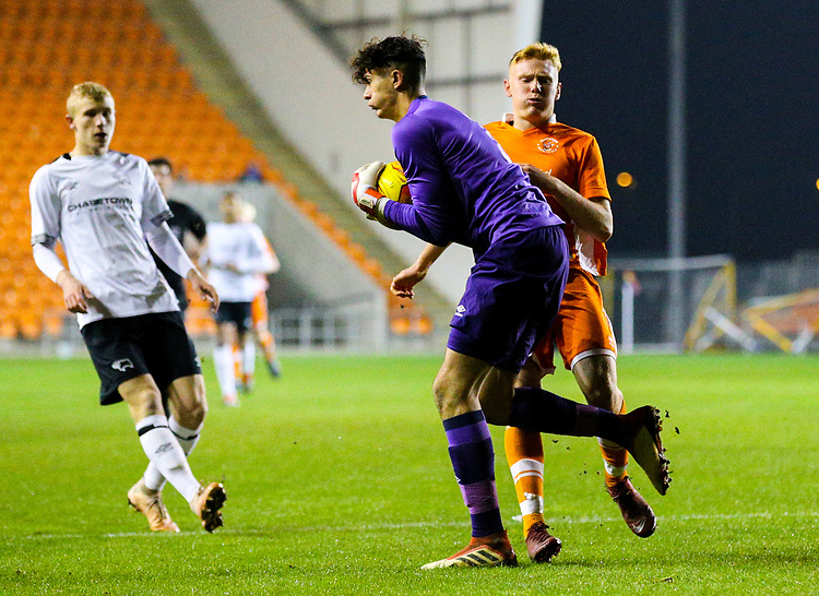 Derby County's Bradley Foster-Theniger claims the ball before Blackpool's Owen Watkinson can reach it<br /> <br /> Photographer Alex Dodd/CameraSport<br /> <br /> The FA Youth Cup Third Round - Blackpool U18 v Derby County U18 - Tuesday 4th December 2018 - Bloomfield Road - Blackpool<br />  <br /> World Copyright &copy; 2018 CameraSport. All rights reserved. 43 Linden Ave. Countesthorpe. Leicester. England. LE8 5PG - Tel: +44 (0) 116 277 4147 - admin@camerasport.com - www.camerasport.com
