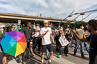 AUSTIN, TEXAS - MAY 30, To the dismay and anger of the crowd, a man wearing a Trump Make America Great Again t-shirt is escorted out of the Black Lives Matter protest on May 30, 2020 in Austin, Texas.<br /> <br /> Use of this image in advertising or for promotional purposes is prohibited.<br /> <br /> Editorial Credit: Photo by Dan Herron / Herron Stock