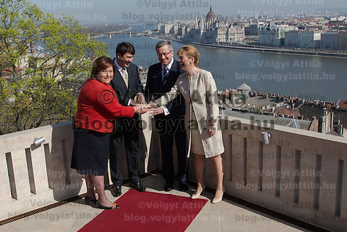 Bronislaw Komorowski (2nd R) president of Poland and his Hungarian counterpart Janos Ader (2nd L) accompanied by their wives Anna Komorowska (L) and Anita Herczeg (R) have a sight-viewing together after a welcoming ceremony in Budapest, Hungary on March 21, 2014. ATTILA VOLGYI