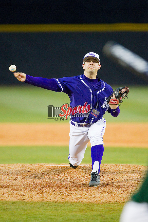 High Point Panthers relief pitcher Kyle Wigmore (15) delivers a pitch to the plate against the Charlotte 49ers at Willard Stadium on February 20, 2013 in High Point, North Carolina.  The 49ers defeated the Panthers 12-3.  (Brian Westerholt/Sports On Film)
