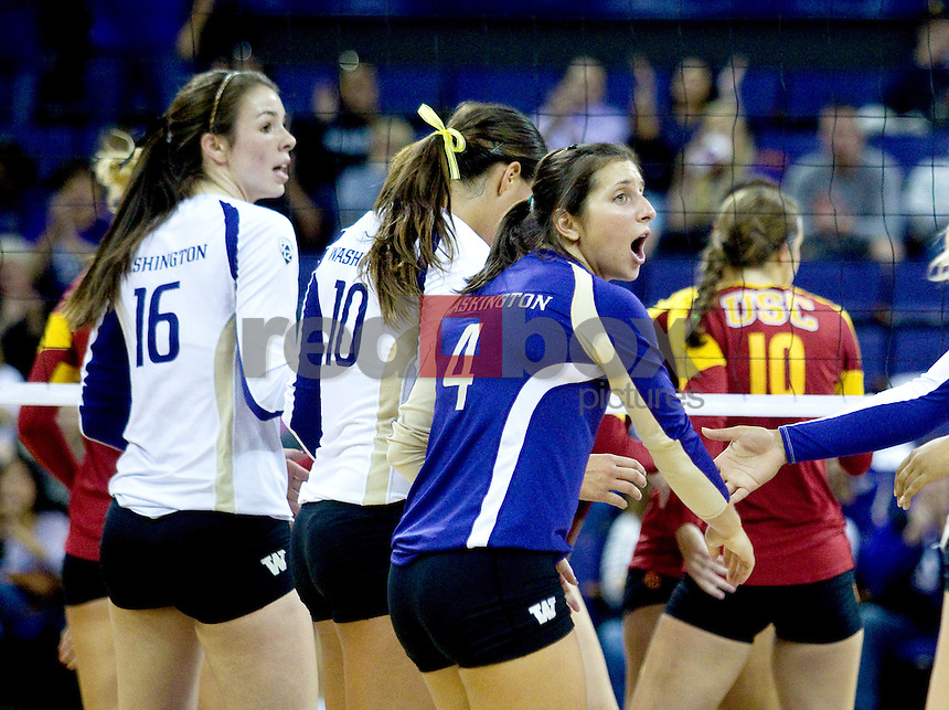 Krista Vansant,  Evan Sanders, Jenna Orlandini  The University of Washington women's volleyball team plays USC Trojans at Alaska Airlines Arena at the University of Washington in Seattle on Friday September 16, 2011. (Photography By Scott Eklund/Red Box Pictures)