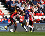 Paul Coutts of Sheffield Utd and Didier NDong of Sunderland during the Championship match at the Stadium of Light, Sunderland. Picture date 9th September 2017. Picture credit should read: Simon Bellis/Sportimage