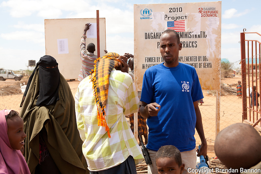Somali refugees in Dagahaley camp look for their names on a list of people to be transfered from the self-settled outskirts of Dagahaley to the  new Ifo extension tented camp. The refugees are relocated with the help of IOM. September 28, 2011.