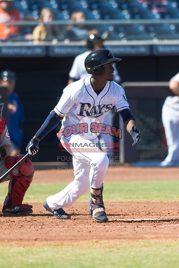 Peoria Javelinas shortstop Lucius Fox (5), of the Tampa Bay Rays organization, follows through on his swing during an Arizona Fall League game against the Scottsdale Scorpions at Peoria Sports Complex on October 18, 2018 in Peoria, Arizona. Scottsdale defeated Peoria 8-0. (Zachary Lucy/Four Seam Images)