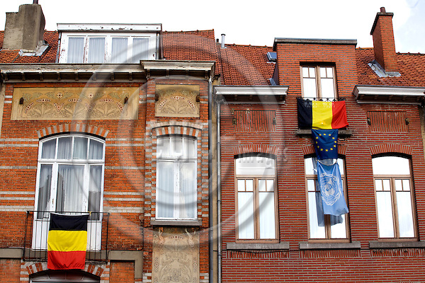 BRUSSELS - BELGIUM - 30 SEPTEMBER 2007 -- In the last couple of weeks sales of the Belgian flag have tripled as Belgian people, mainly in Brussels, show their support for Belgian unity by hanging up the the Belgian flag, the black-yellow-red tricolor, from windows and balconies. Talk of division has grown as Flemish and Francophone parties have failed to form a coalition government since June 10 federal elections. The owner of the house on the right has even gone so far to shows his prioritized support for Belgium, then EU and UN. Photo: Erik Luntang/EUP-IMAGES