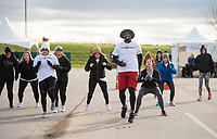 NWA Democrat-Gazette/BEN GOFF @NWABENGOFF<br /> Alex Peoples, Action 2 Produce Boot Camp instructor, leads a group workout Saturday, April 14, 2018, during the American Heart Association's annual Northwest Arkansas Heart Walk at the Walmart AMP in Rogers.