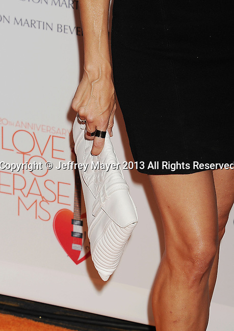CENTURY CITY, CA- MAY 03: Actress Catherine Bell (handbag, rings detail) at the 20th Annual Race To Erase MS Gala 'Love To Erase MS' at the Hyatt Regency Century Plaza on May 3, 2013 in Century City, California.