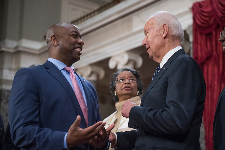 UNITED STATES - JANUARY 03: Sen. Tim Scott, R-S.C., and his mother Frances talk with Vice President Joe Biden during a swearing-in ceremony in the Capitol's Old Senate Chamber, January 03, 2017. (Photo By Tom Williams/CQ Roll Call)