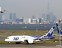 September 28, 2011, Tokyo, Japan - The first all-new Boeing 787 Dreamliner aircraft ordered by All Nippon Airways Co. taxis after landing at Tokyos Haneda Airport on a flight from Everett, Wash., on Wednesday, September 28, 2011. The world's first carbon-composite passenger jetliner will make commercial flights on a route between Narita International Airport, east of Tokyo, and Hong Kong. The Tokyo Sky Tree looms in the right background. (Photo by AFLO) [3609] -mis-