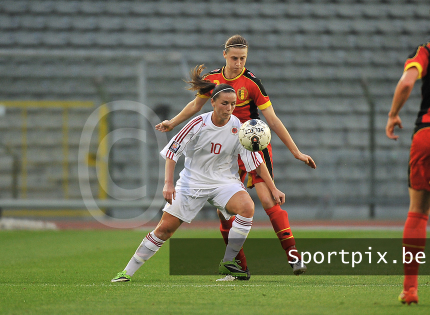 20130921 - BRUSSELS , BELGIUM : Albanian Velaj Furtuna pictured with Belgian Heleen Jaques in her back during the female soccer match between Belgium and Albania , on the first matchday in group 5 of the UEFA qualifying round to the FIFA Women World Cup in Canada 2015 at the Koning Boudewijn Stadion , Brussels . Saturday 21th September 2013. PHOTO DAVID CATRY