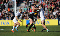 Harry Sloan of Harlequins is tackled by Tom Fowlie and Shane Geraghty of London Irish during the Aviva Premiership Rugby match between Harlequins and London Irish at The Twickenham Stoop on Saturday 7th March 2015 (Photo by Rob Munro)