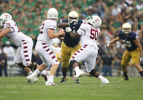 August 31, 2013:  Notre Dame defensive lineman Louis Nix III (1) and Temple offensive lineman Jeff Whittingham (50) battle at the line of scrimmage during NCAA Football game action between the Notre Dame Fighting Irish and the Temple Owls at Notre Dame Stadium in South Bend, Indiana.  Notre Dame defeated Temple 28-6.