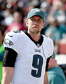 Philadelphia Eagles reserve quarterback Nick Foles (9) looks at the scoreboard in the fourth quarter of the game against the Washington Redskins at FedEx Field in Landover, Maryland on Sunday, September 10, 2017.  The Eagles won the game 30 - 17.<br /> Credit: Ron Sachs / CNP