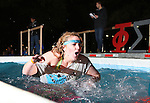 SCEC jumper Allyson Shirley comes out of the water at the University of Kentucky Phi Sigma Kappa Polar Plunge philanthropy event at South Campus benefitting the Special Olympics in Lexington, Ky., on Thursday, November 14, 2013. Photo by Tessa Lighty | Staff