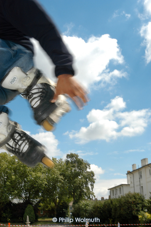 A skateboarder uses a temporary mobile track in a Haringey park.