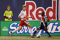 New York Red Bulls midfielder Dave van den Bergh (11) and New England Revolution midfielder Sainey Nyassi (31). The New York Red Bulls and the New England Revolution played to a 1-1 tie during a Major League Soccer match at Giants Stadium in East Rutherford, NJ, on April 19, 2008.