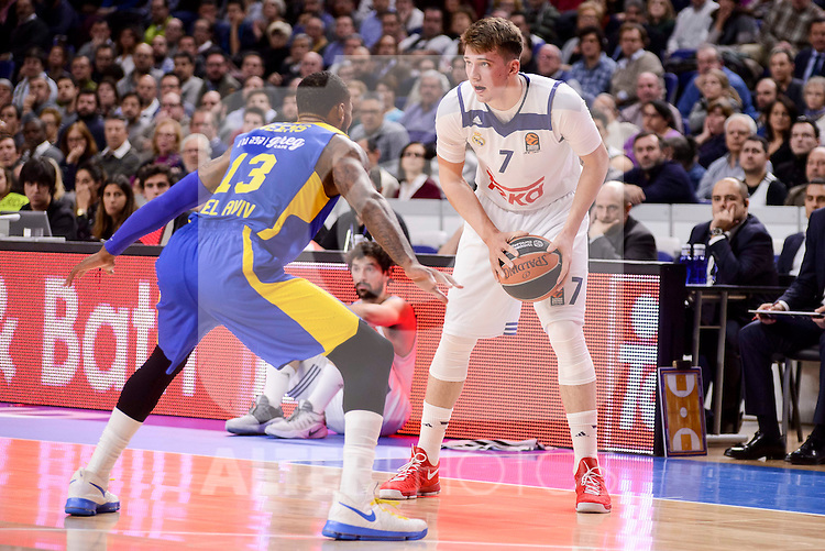 Real Madrid's Luka Doncic and Maccabi Fox's Sonny Weens during Turkish Airlines Euroleague match between Real Madrid and Maccabi at Wizink Center in Madrid, Spain. January 13, 2017. (ALTERPHOTOS/BorjaB.Hojas)