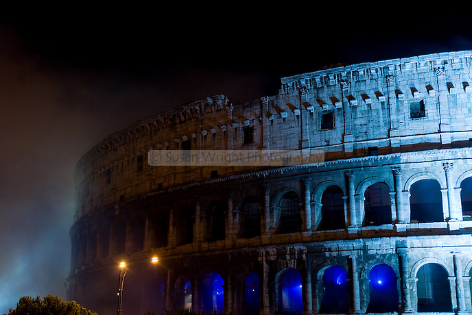 Colosseum illuminated in blue light on a misty night, Rome, Italy