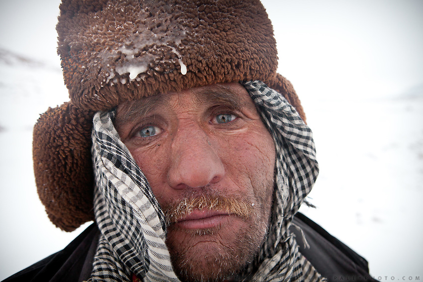 Wakhi caravan leader Shukr Ali is exhausted after several days walk in a blizzard with not much to eat..Between Ech Keli and Burgut Yor...Trekking with yak caravan through the Little Pamir where the Afghan Kyrgyz community live all year, on the borders of China, Tajikistan and Pakistan.