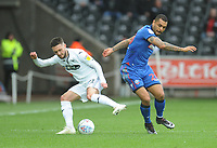 Bolton Wanderers' Josh Magennis vies for possession with Swansea City's Matt Grimes<br /> <br /> Photographer Kevin Barnes/CameraSport<br /> <br /> The EFL Sky Bet Championship - Swansea City v Bolton Wanderers - Saturday 2nd March 2019 - Liberty Stadium - Swansea<br /> <br /> World Copyright © 2019 CameraSport. All rights reserved. 43 Linden Ave. Countesthorpe. Leicester. England. LE8 5PG - Tel: +44 (0) 116 277 4147 - admin@camerasport.com - www.camerasport.com